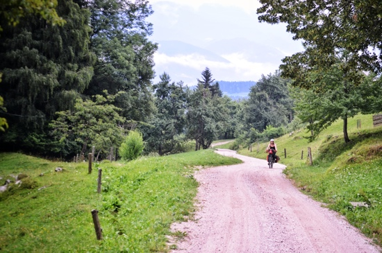 Climbing gravel roads on a loaded touring bike requires good strategy; two wheel travel; bicycle touring Slovenia
