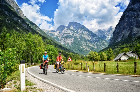 Bicycle touring in the Julian Alps requires a good strategy to climb over the mountians on a loaded touring bike.