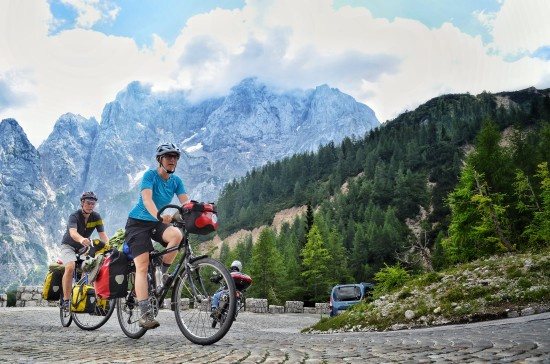 climbing vrsic pass on loaded touring bikes; two wheel travel; slovenia; bicycle touring