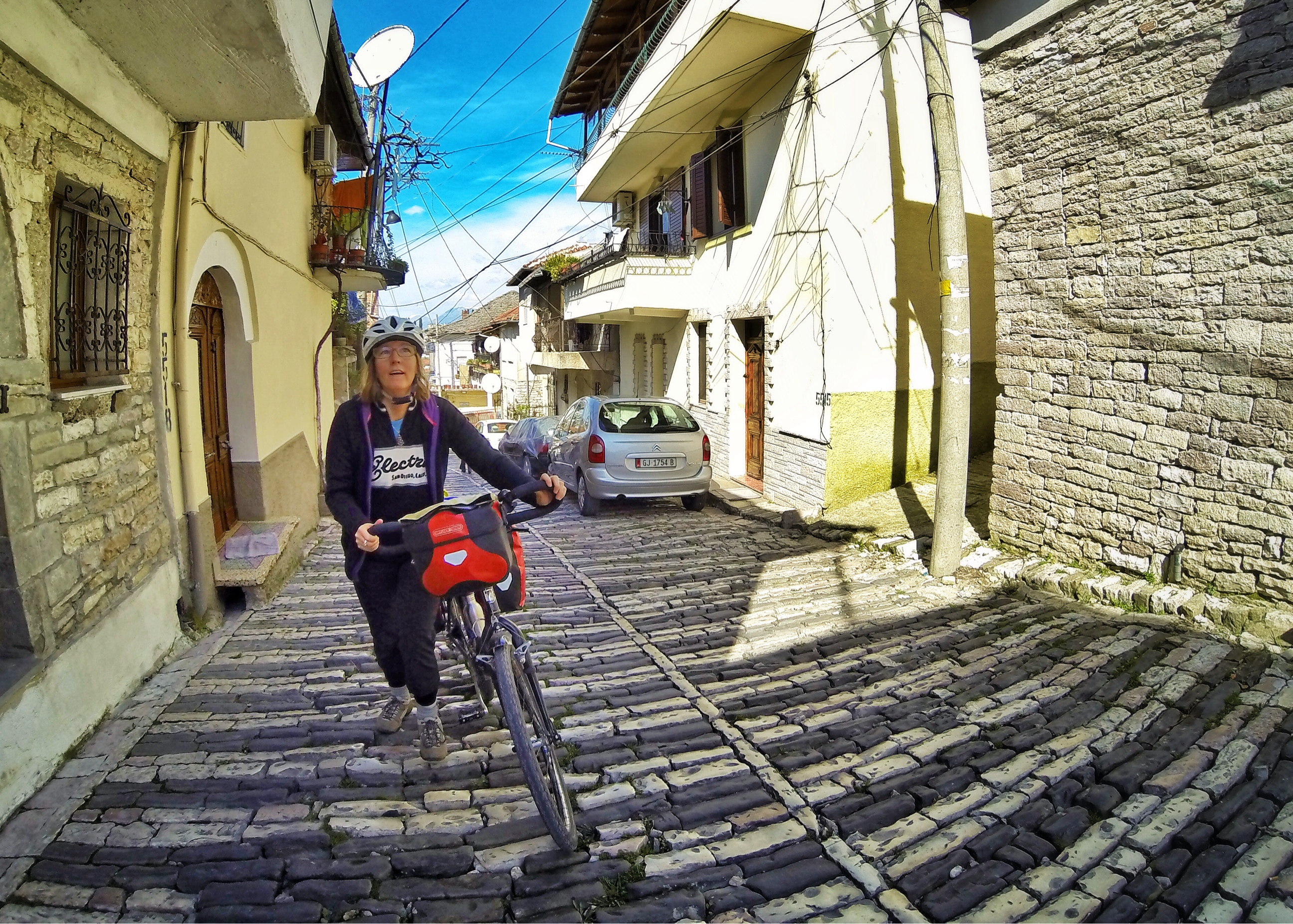 Bicycle Touring Albania. Pushing up the steep cobblestone streets of Gjirokaster