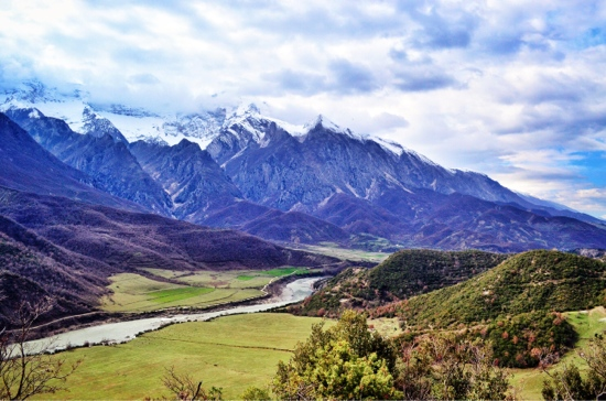 Bicycle Touring Albania. Lumi Vjosa River surrounded by mountains