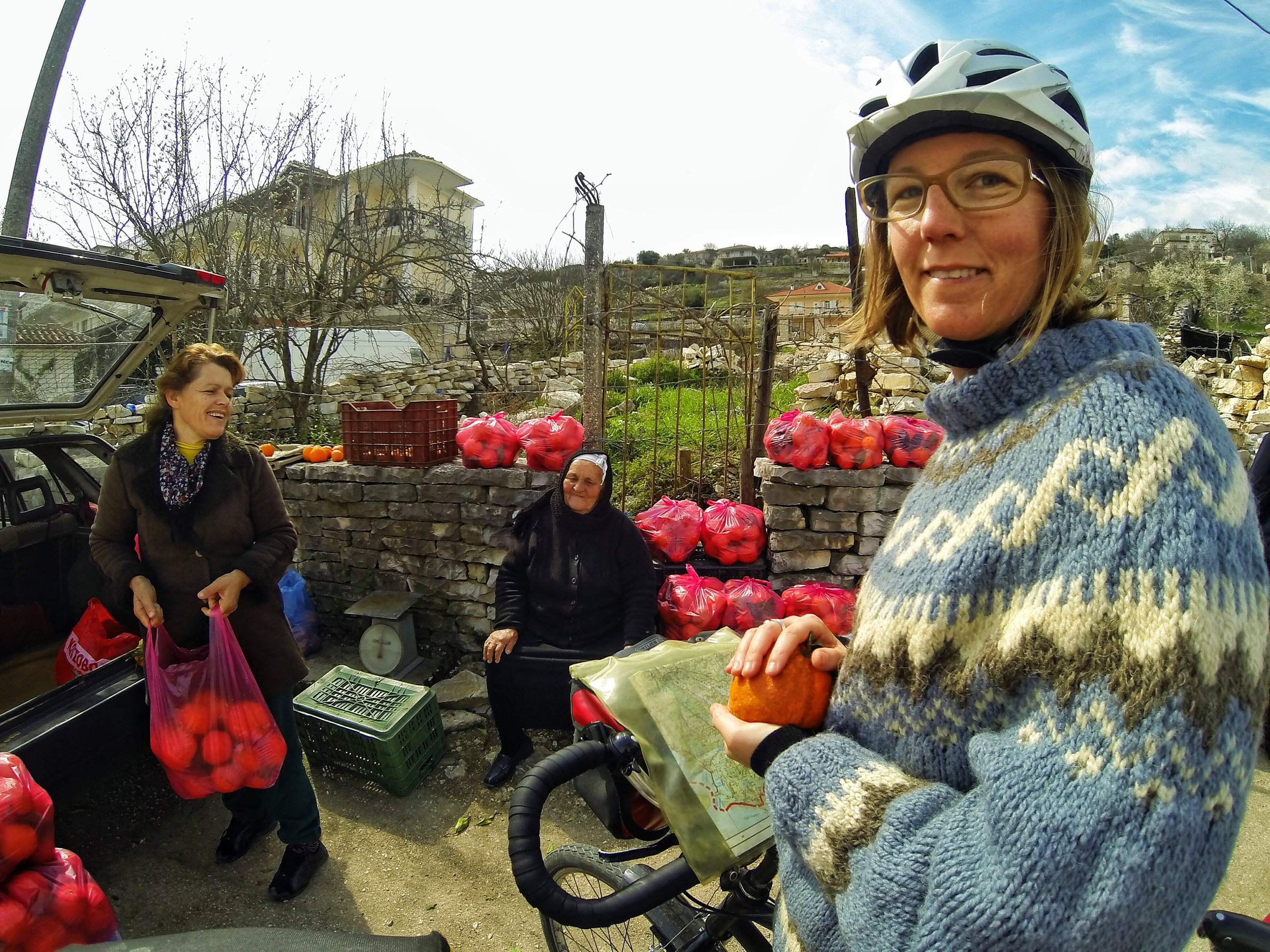 Bicycle Touring Albania. Buying Oranges on the roadside from friendly locals